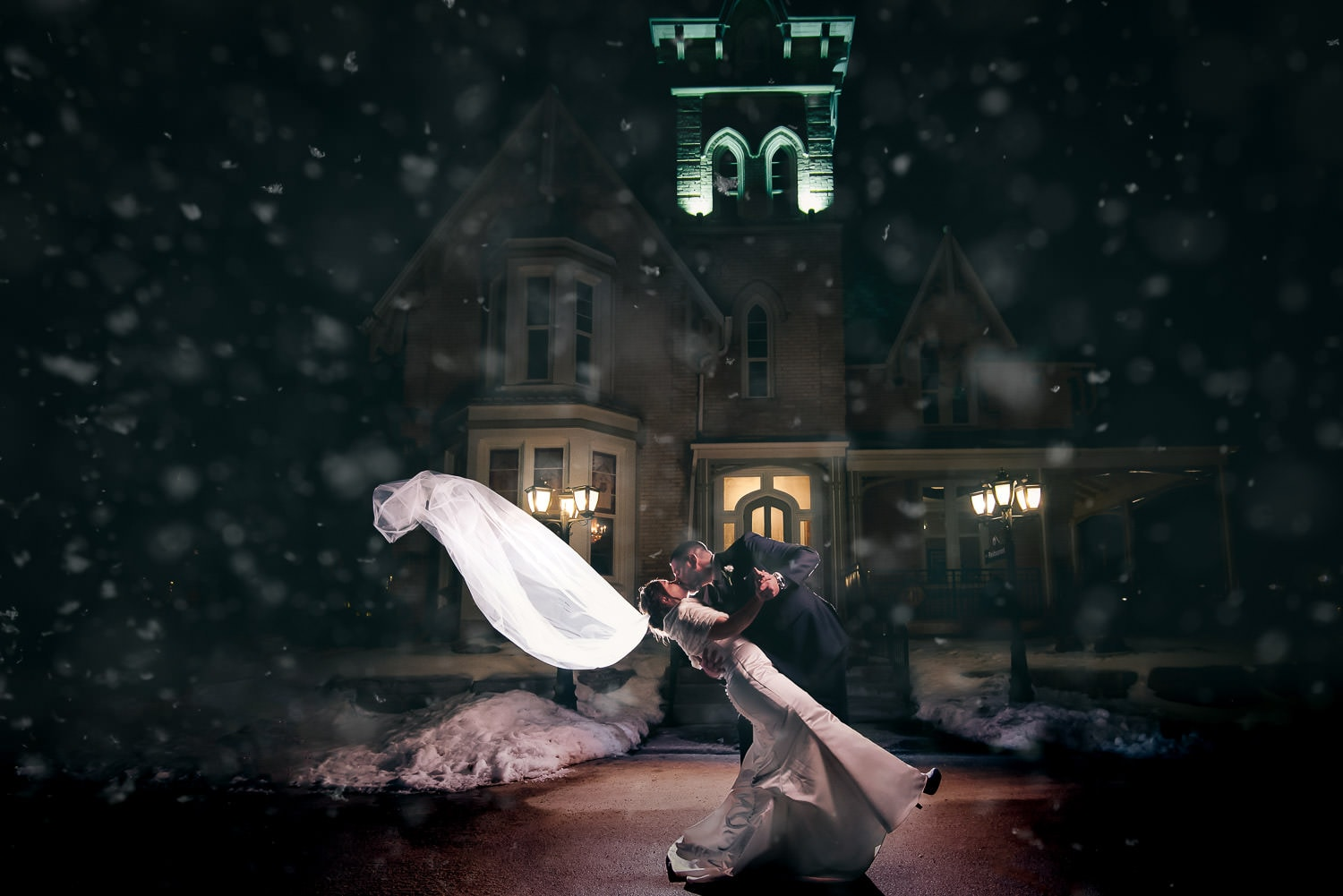 beautiful nighttime winter wedding photo at elmhurst inn