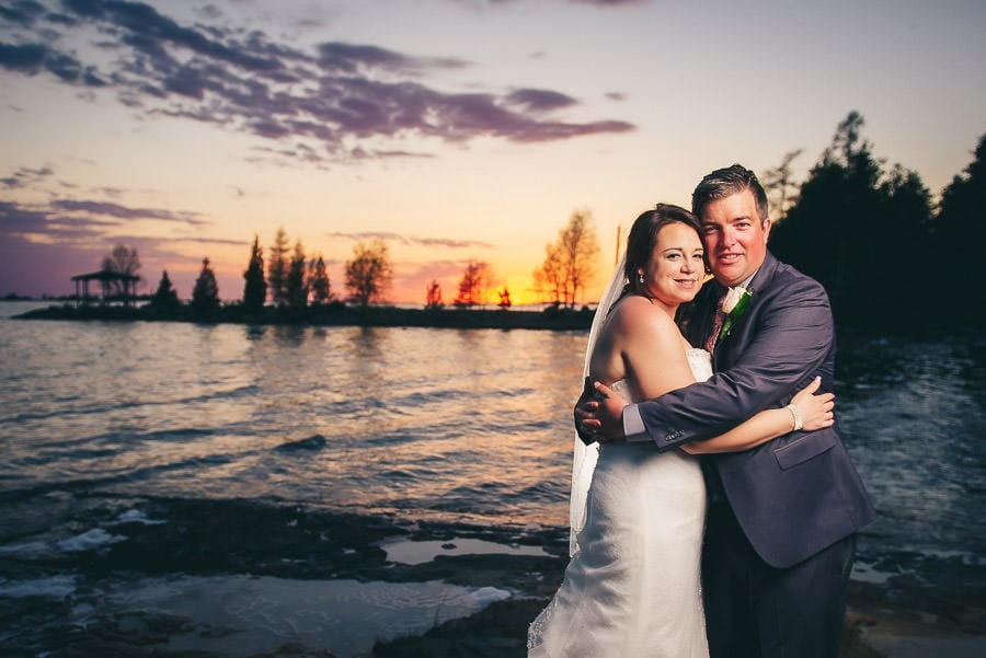 bride and groom on beach at dusk