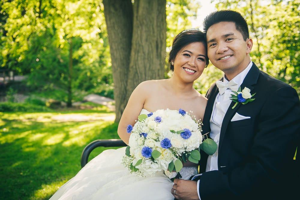 bride and groom wedding portrait in civic gardens in London Ontario