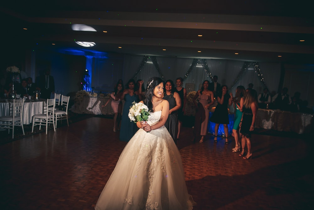 throwing the bouquet at London Ontario wedding at brookside banquet centre