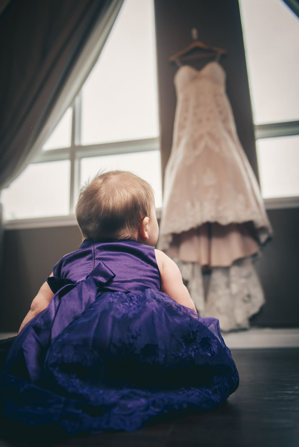 Baby looking at wedding dress at Elmhurst Inn