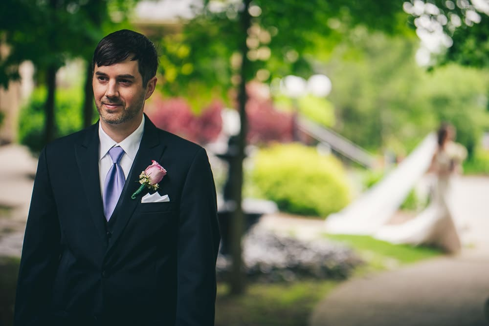 groom waiting to see bride for first look at Elmhurst Inn