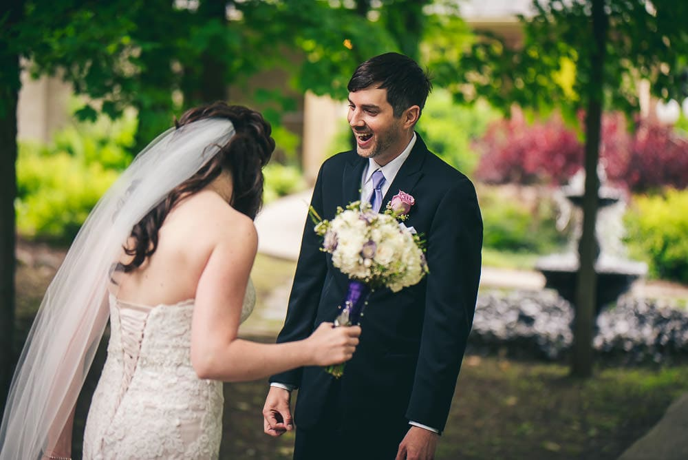 groom sees his bride for the first time  before their wedding at the Elmhurst Inn
