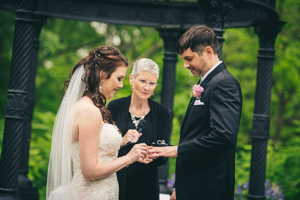 bride and groom exchanging rings at wedding ceremony