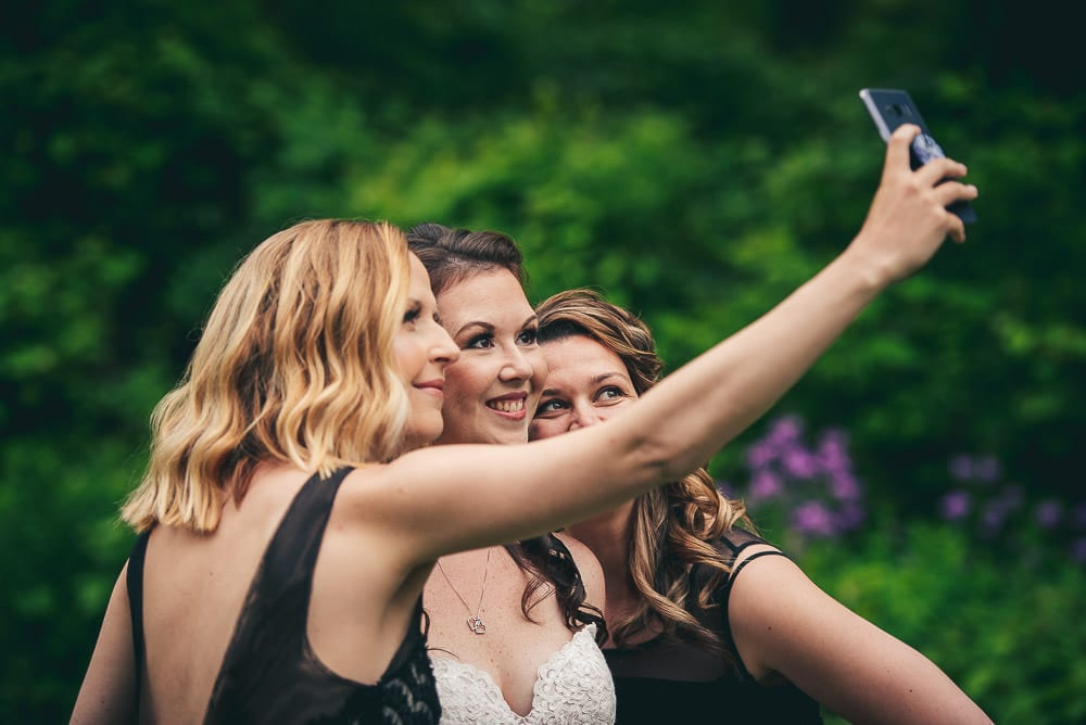 bride taking selfie at the Elmhurst Inn wedding