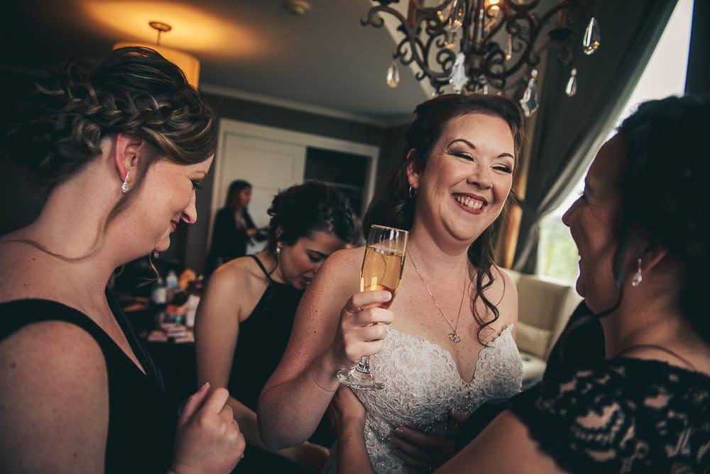 bride laughing while getting ready at Elmhurst Inn for wedding