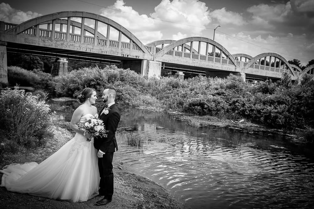 bride and groom at Schneider Park Kitchener overlooking the Grand River
