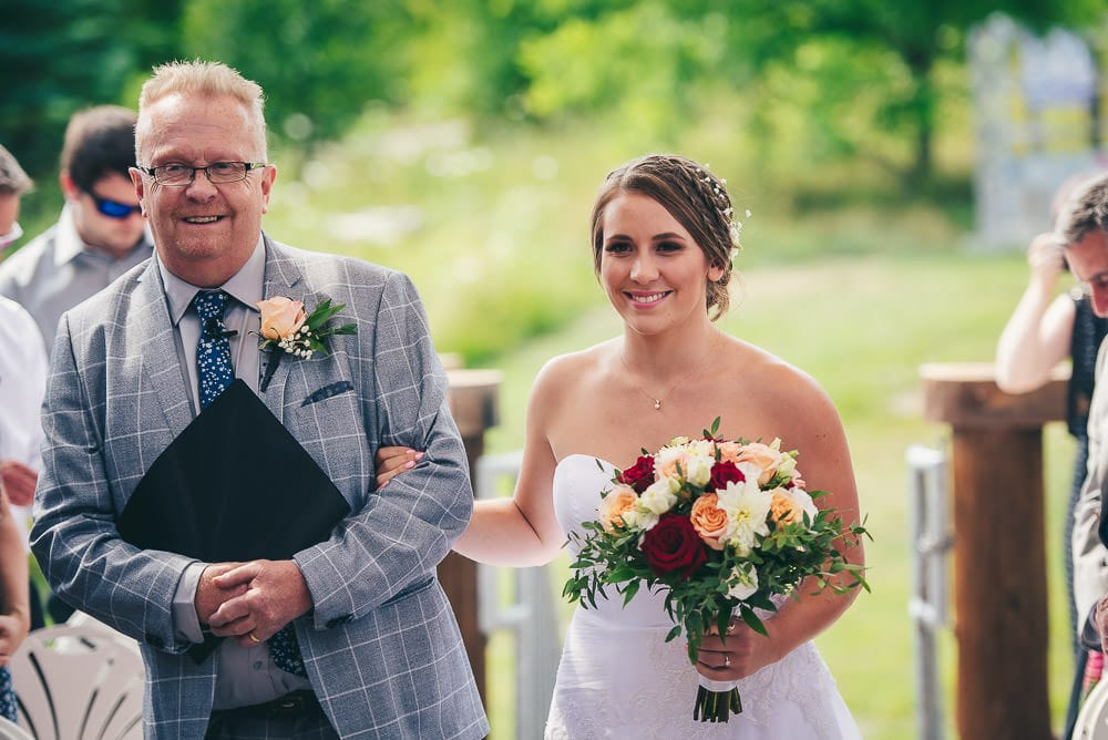 father walking daughter down the aisle at wedding at pine Vally chalet Kitchener