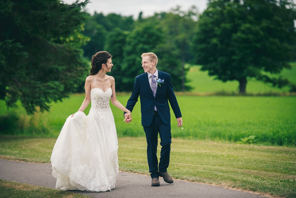 bride and groom walking at Mitchell golf club