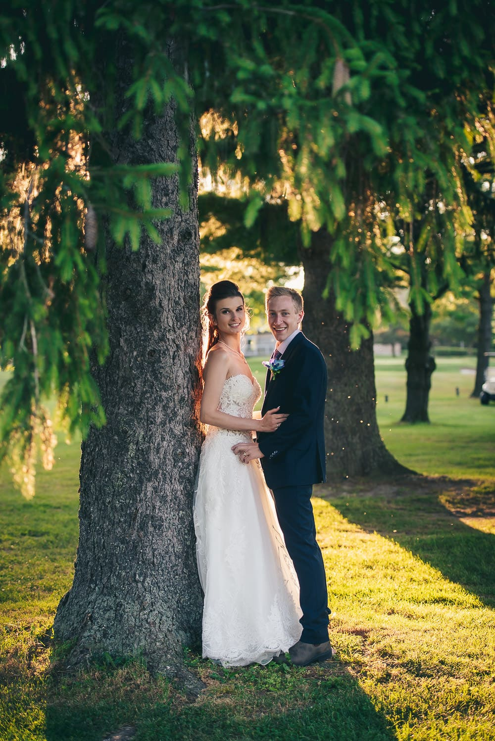 bride and groom wedding photo at golden hour in Mitchell golf club