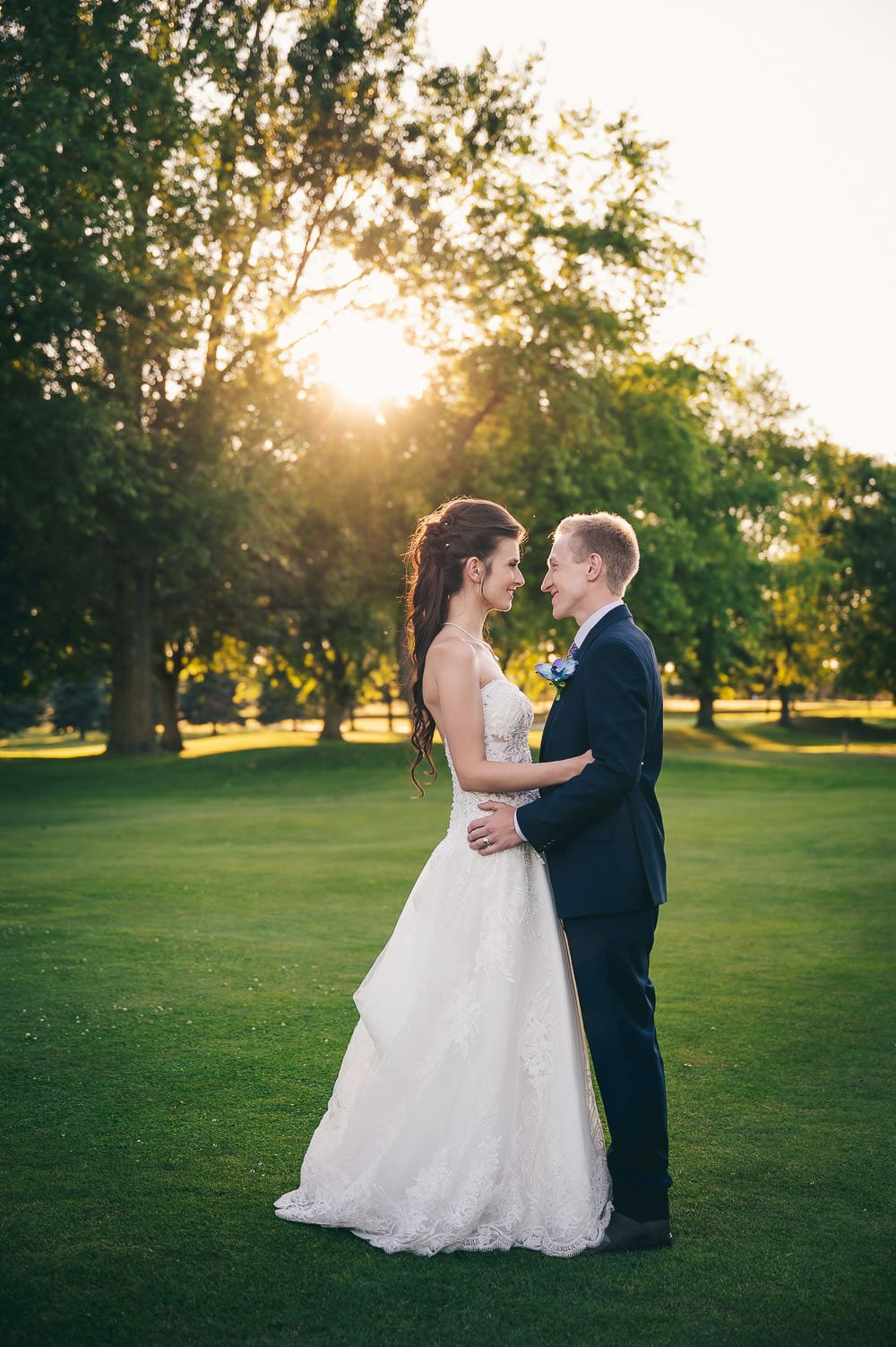 golden hour wedding photo on golf course in Mitchell Ontario