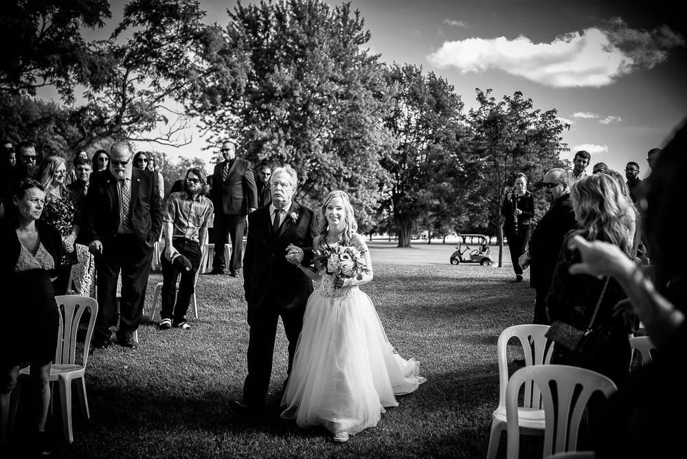 father walking daughter down the aisle at her wedding at craigowan golf club