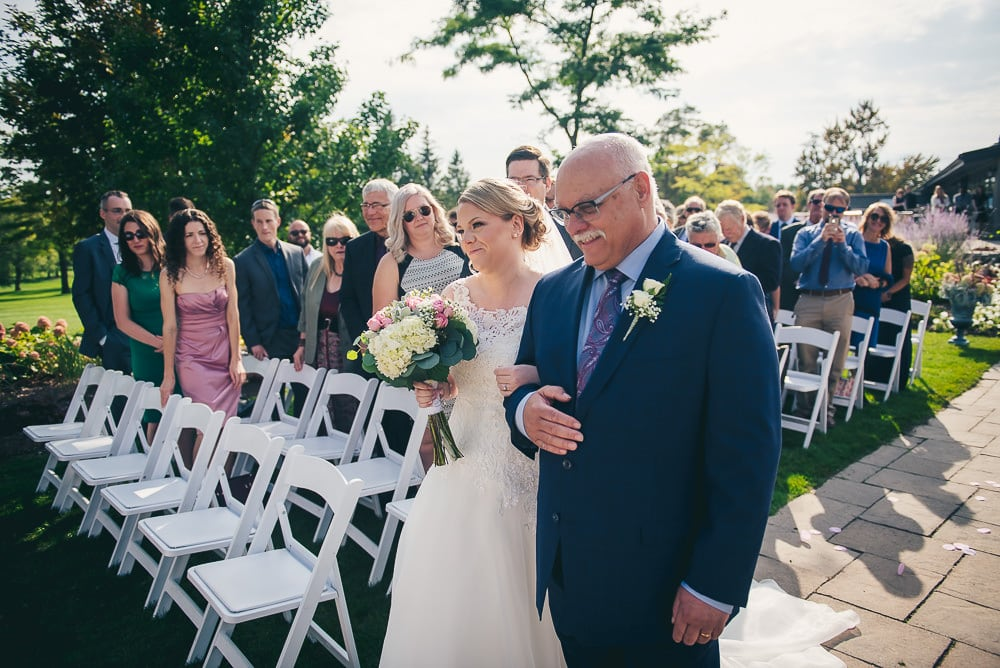 father walking daughter down the aisle at Stratford country club wedding