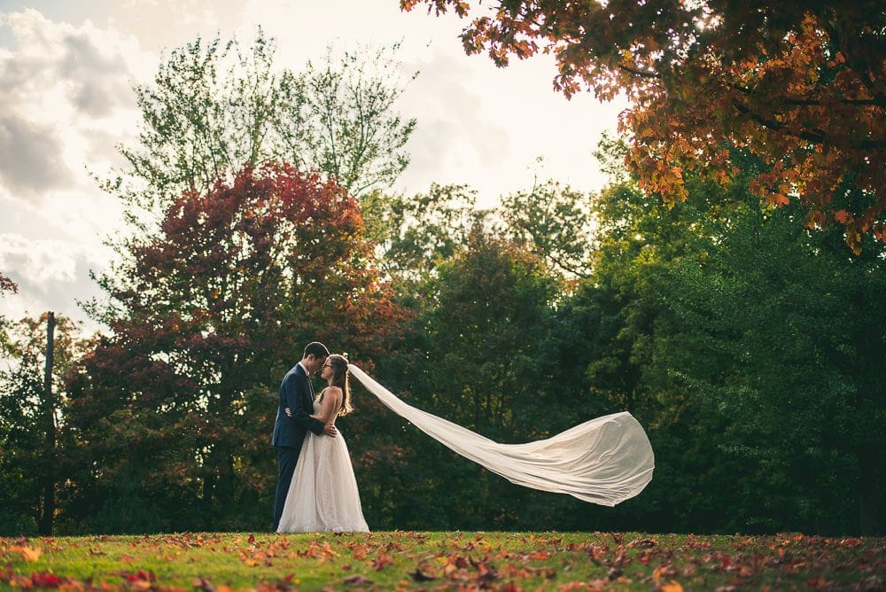 bride and groom photo at elsie Perrin wedding with long veil in London Ontario